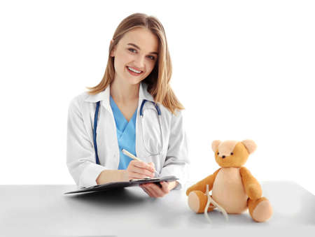 Young beautiful female doctor working at the table Stock Photo