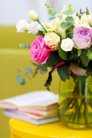 Vase with fresh roses in the room Stock Photo