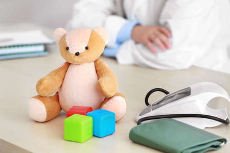 Teddy bear and doctor on background Archivio Fotografico