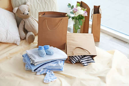 New baby clothes on bed Banque d'images