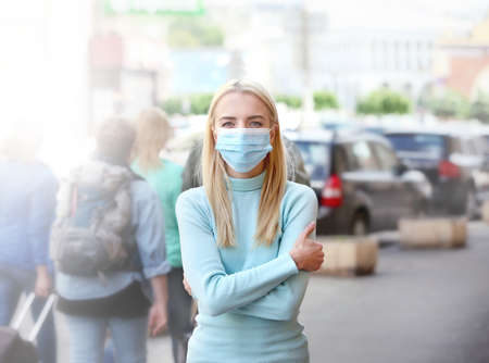 Woman in protective mask outdoors Imagens