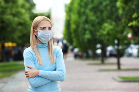 Woman in protective mask outdoors Stockfoto