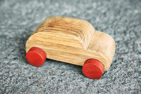 Wooden toy car on a asphalt