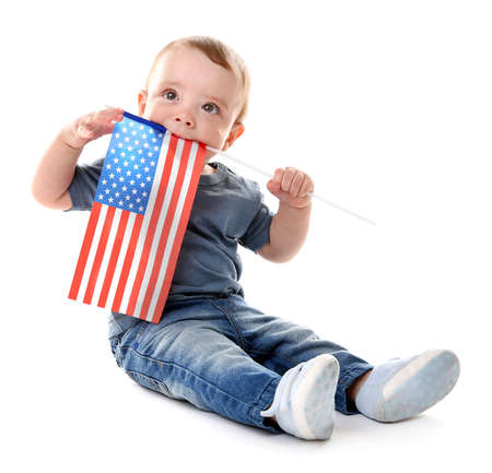 Baby boy and American flag, isolated on white