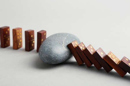 Dominoes and grey stone on grey background