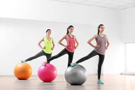 Young women doing exercise with ball