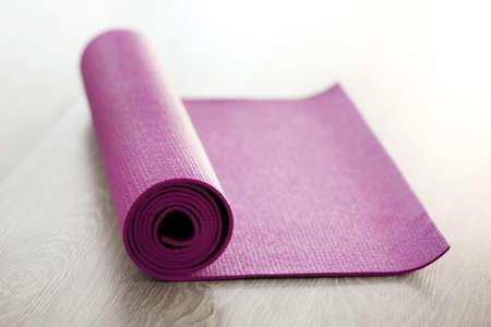 Mat for fitness on wooden floor