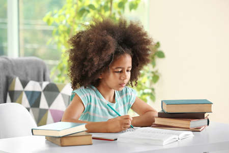 Cute African girl doing homework