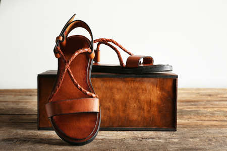 New leather sandals and gift box on the table