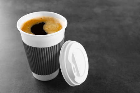 Coffee-to-go. Paper cup of coffee on the table Imagens