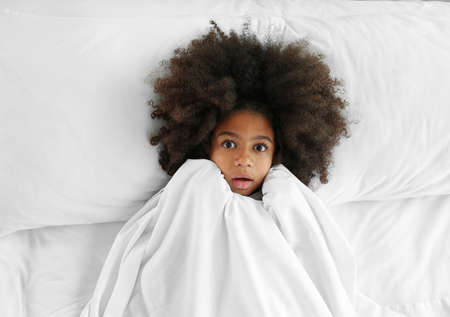 Cute African girl in bed