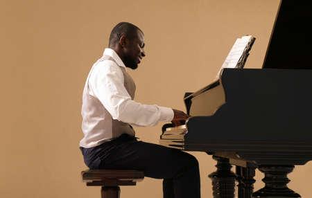 Afro American man playing piano