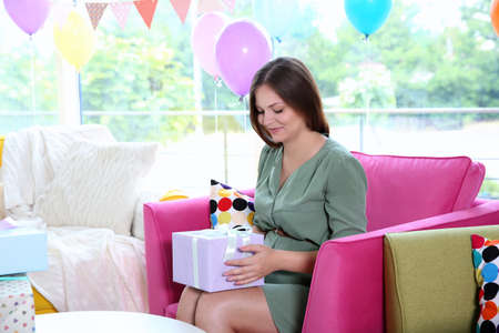 Pregnant woman with presents at baby shower party Stock Photo