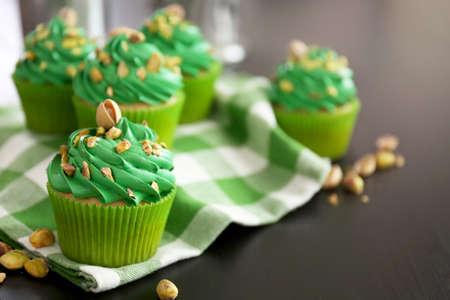 Pistachio cupcakes on napkin
