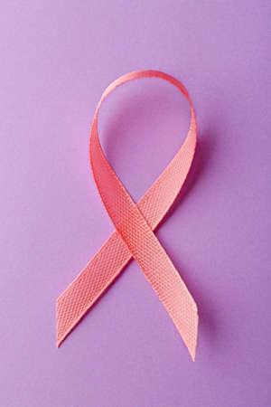 Pink ribbon symbol on light purple background Stock fotó