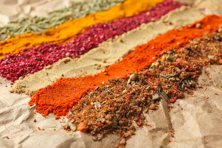 Different spices on parchment background