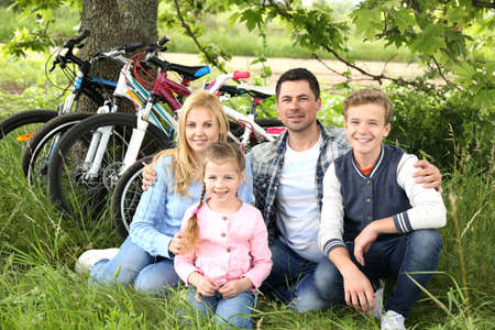 Happy family having rest after bike ride