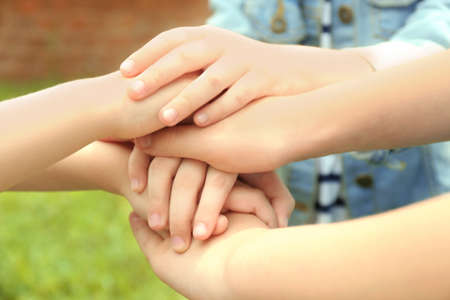 Children holding hands together, closeup Stock Photo