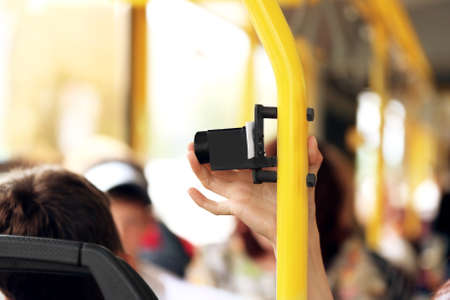 Hand pressing punch on the public transport Stock Photo