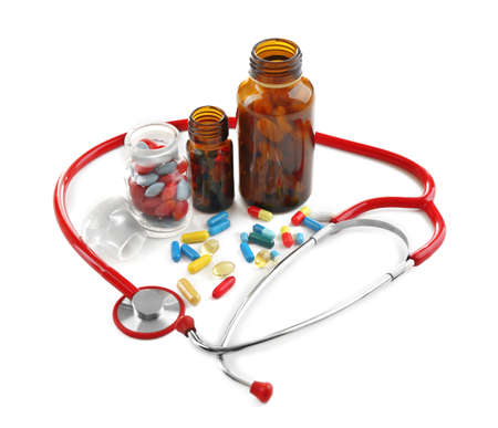 Stethoscope with colorful pills isolated on white background Stok Fotoğraf