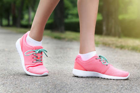 Woman wearing pink sneakers