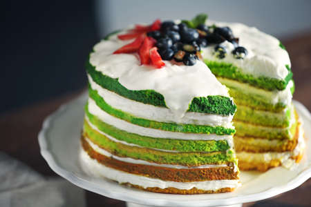 Delicious cake with berries, closeup