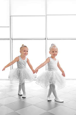 Cute girls practicing ballet in class Stock Photo