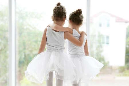 Cute girls looking out window in ballet class