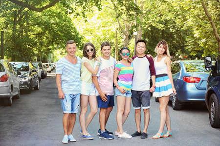 Group of happy teenagers on street