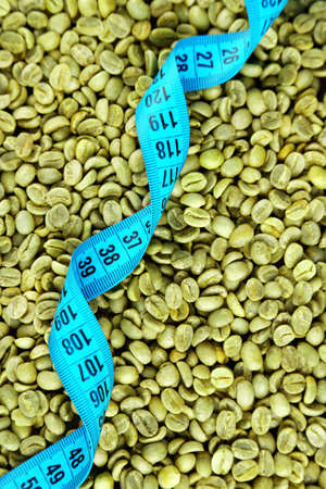Coffee grains and measure tape, closeup