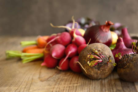 Fresh vegetables on wooden table Stock Photo