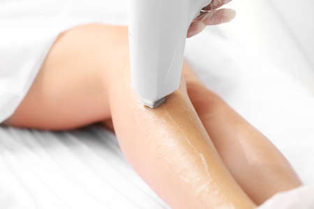 Woman getting laser treatment  in a beauty salon, close up