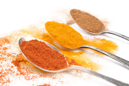 Different spices in spoons on white background 스톡 콘텐츠