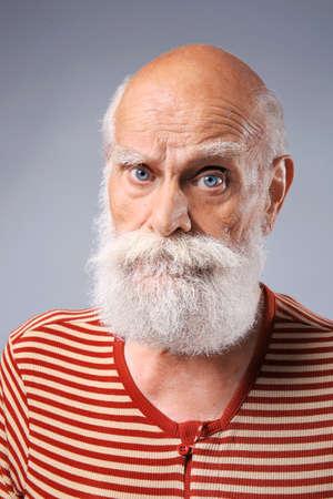 Elderly man in  stylish cloth on grey background Stock Photo