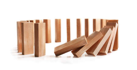 Wooden dominoes on light background 스톡 콘텐츠