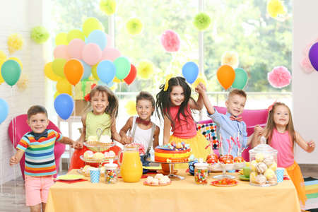 Childrens funny birthday party in decorated room