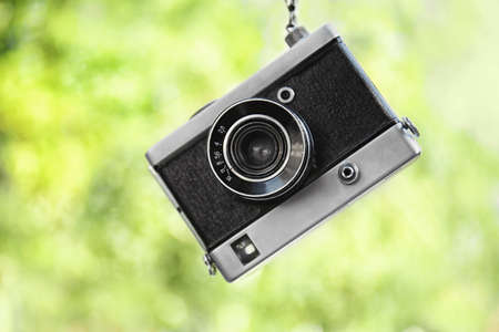 Vintage camera on blurred background Stock Photo