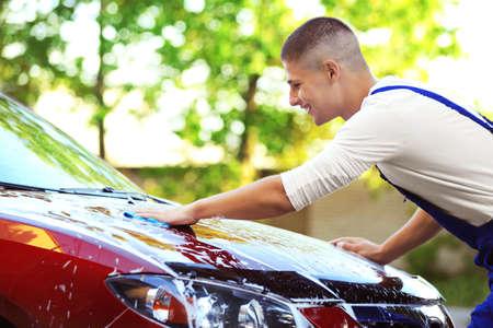Serviceman washing a car Stock Photo