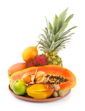 Exotic fruits in a bowl isolated on white