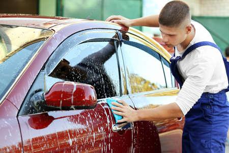 Serviceman washing a car Reklamní fotografie