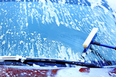 Washing windscreen with window cleaner
