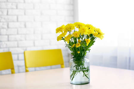 Bouquet of fresh yellow flowers on white table