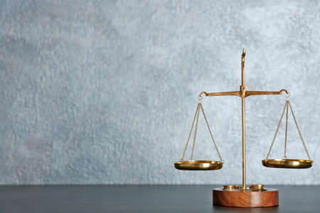 Law scales on a table Stok Fotoğraf