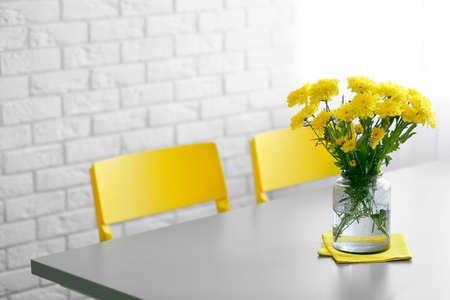 Bouquet of fresh yellow flowers on grey table Stock Photo