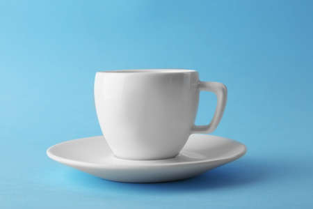 White coffee cup on blue background Stock Photo