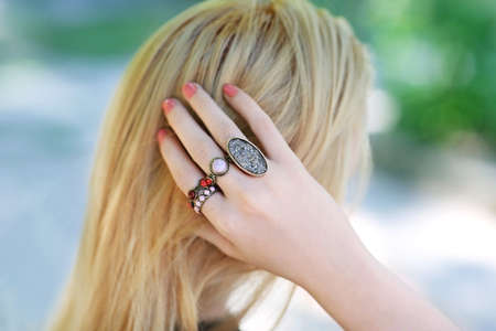 Woman setting hair. Beautiful rings on female hand Reklamní fotografie