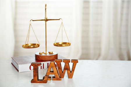 Word Law and scales on a table Stock Photo