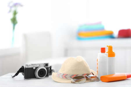 Summer beach set on table in room Stock Photo