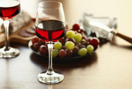 Glasses with wine on served table Stock Photo