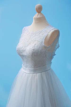 Beautiful wedding dress on wall background Stock Photo